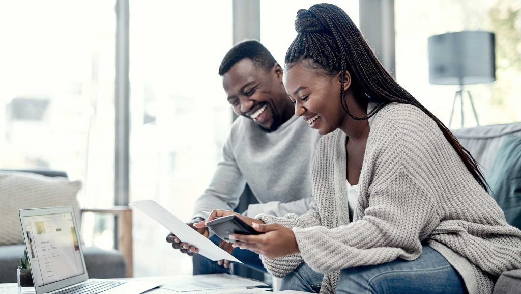 couple checking interest rates on mortgages