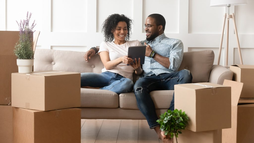a couple using a tablet on moving day