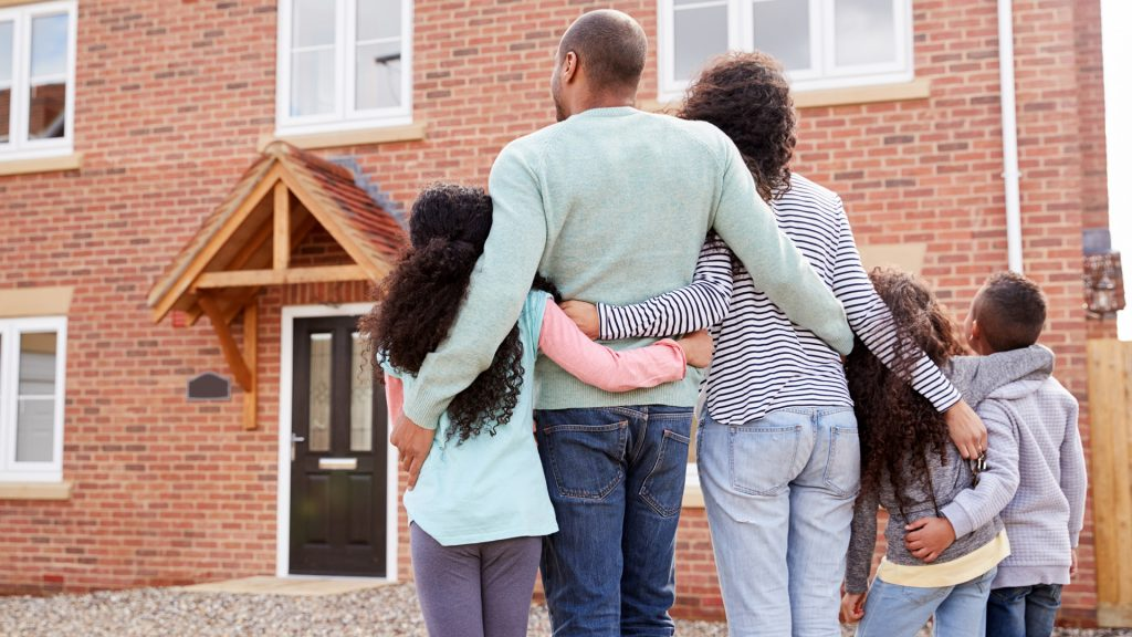 a family looking at a house